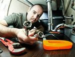 depositphotos_10612606-Plumber-at-work